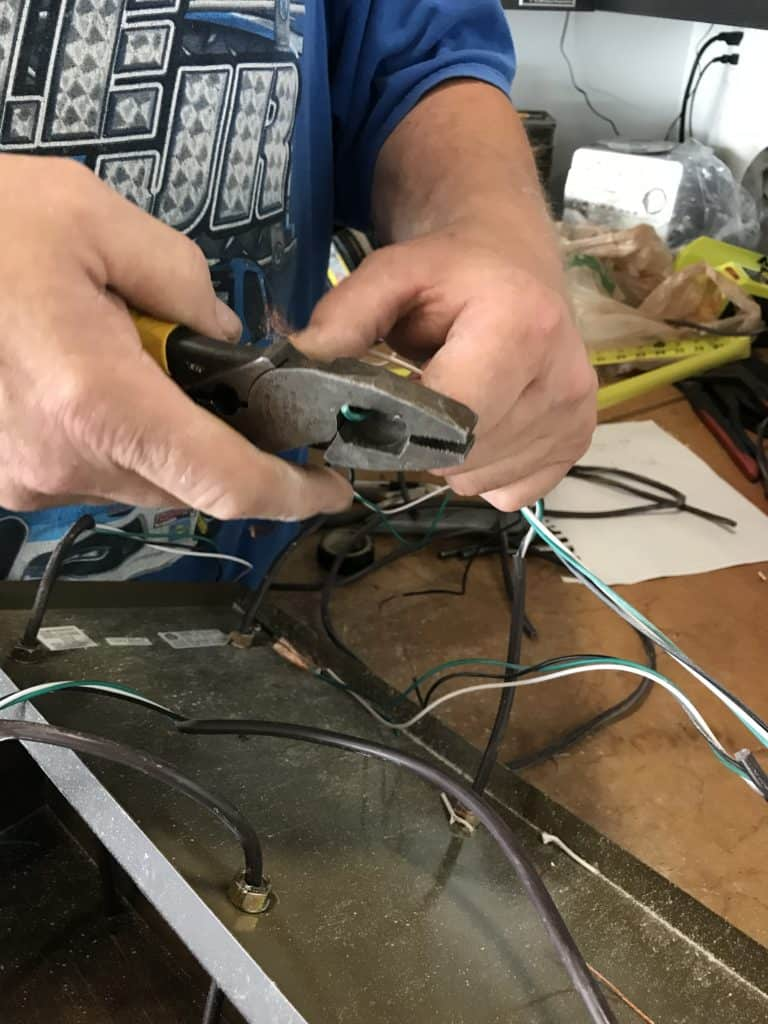 clipping the ends of the wires to attach them for the planter box chandelier