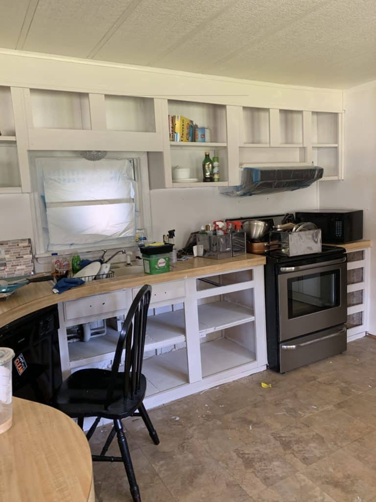 mobile home remodel before and after.  Painting the cabinets.