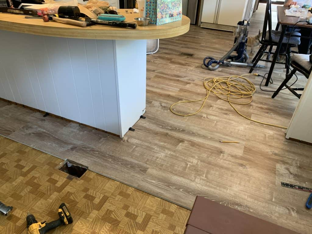 mobile home remodel before and after.  The new flooring in progress.