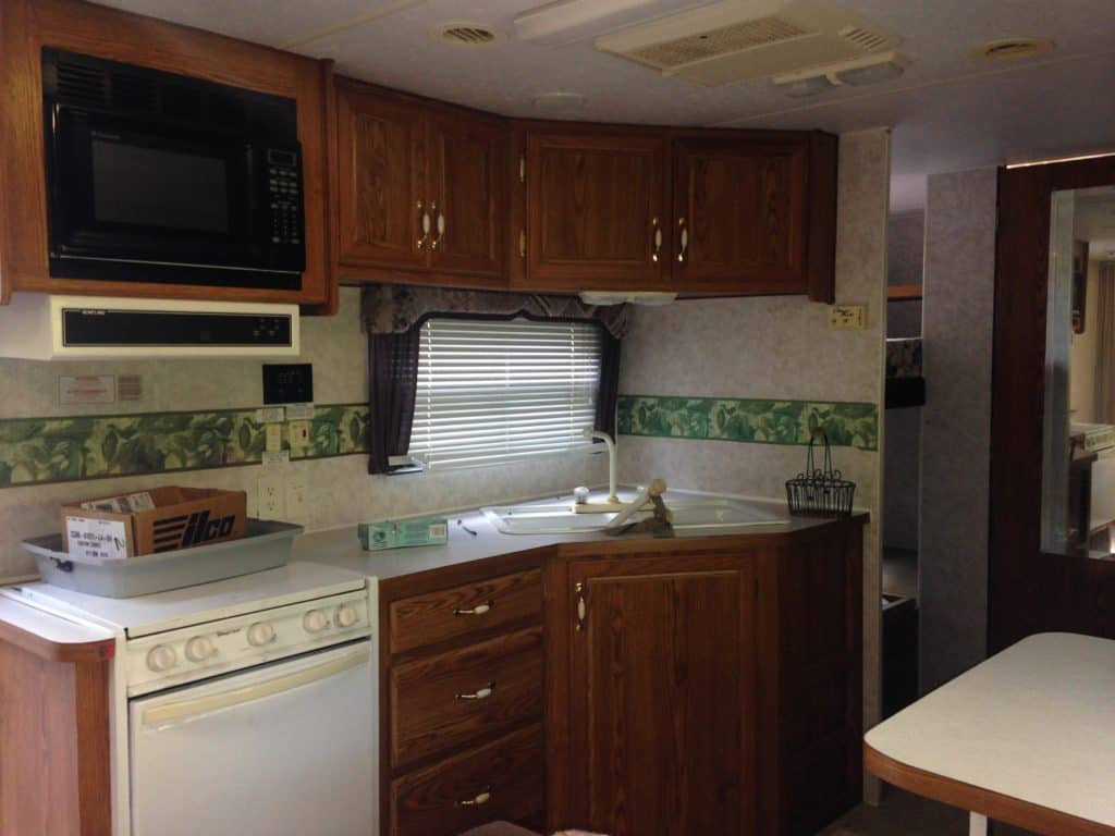 picture of our RV kitchen before it was torn apart.  Camper remodel before and after