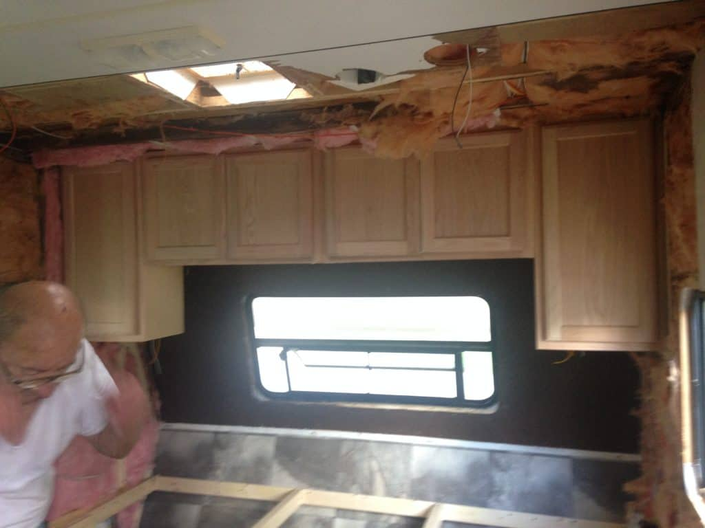 installing the cabinets in our camper remodel before and after