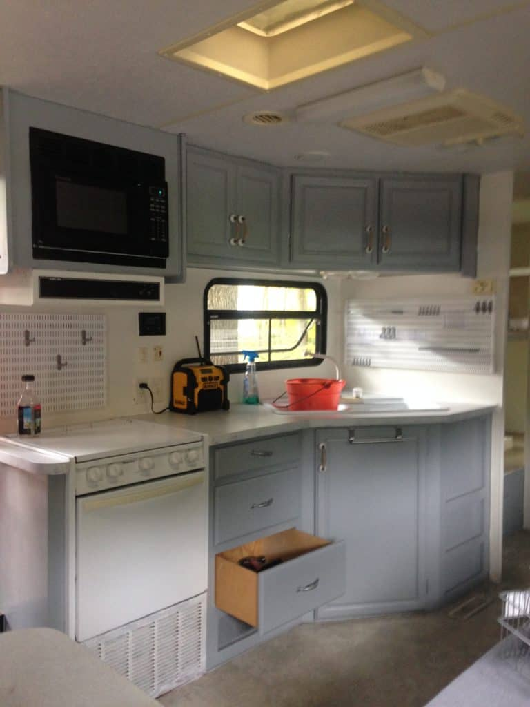 picture of our RV kitchen after painting the cabinets and walls. Camper remodel before and after
