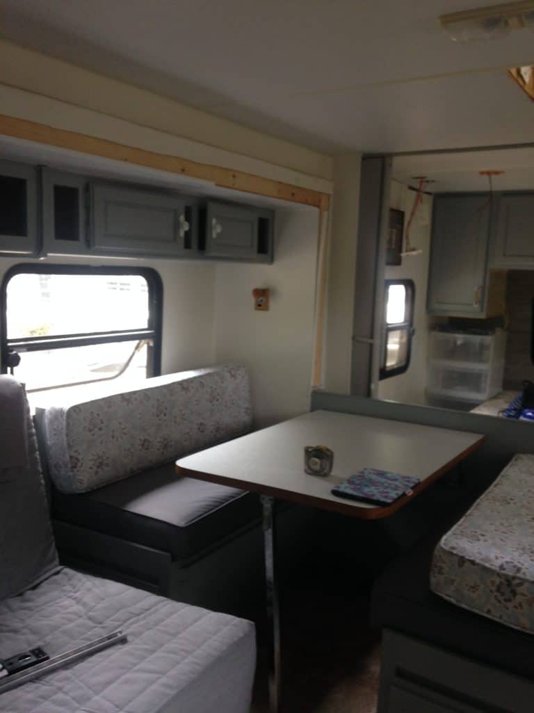 Picture of our banquet seating area in the camper after we moved the location.  Camper remodel before and after