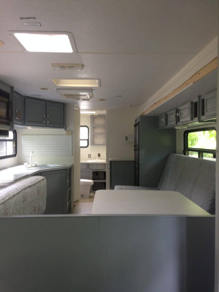 picture of our RV after painting the cabinets and walls. Camper remodel before and after