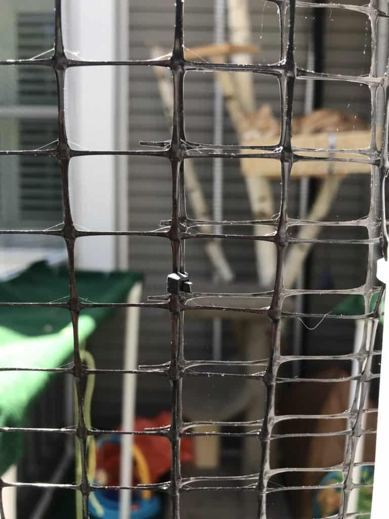 close up of netting attached with zip ties for a custom made catio or cat enclosure made with PVC