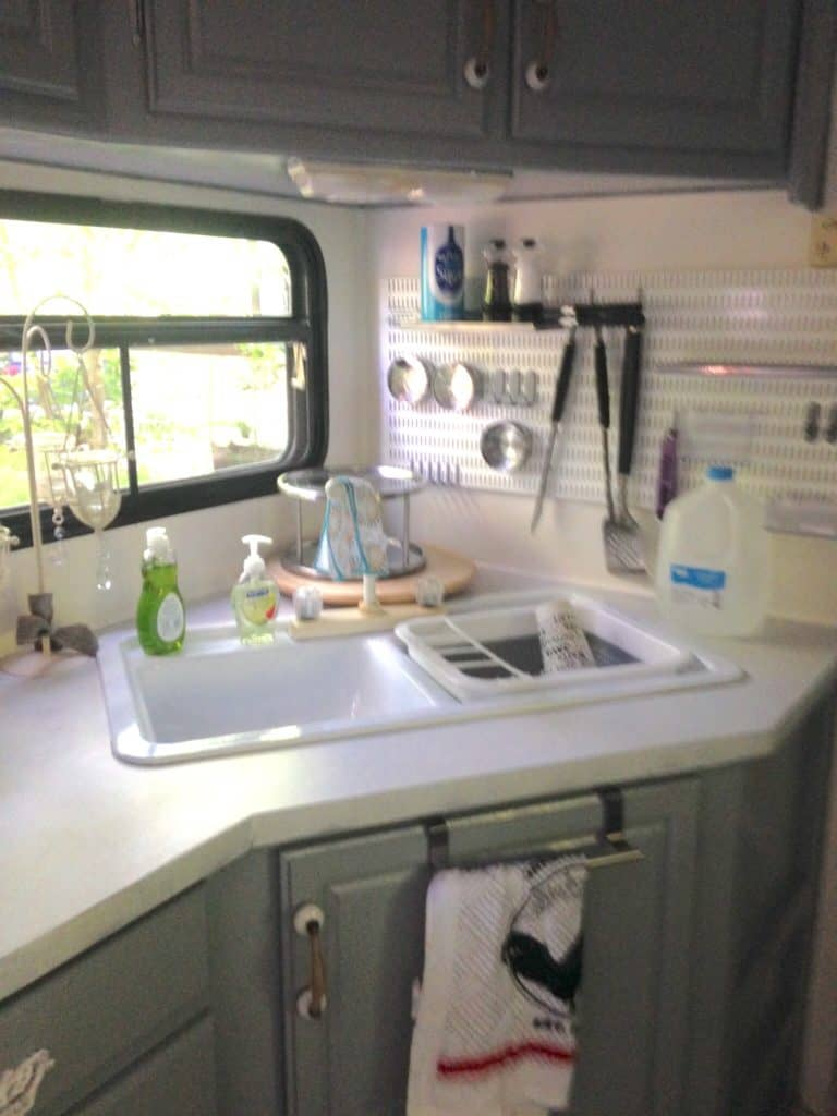 picture of our RV kitchen after painting walls and cabinets. Camper remodel before and after