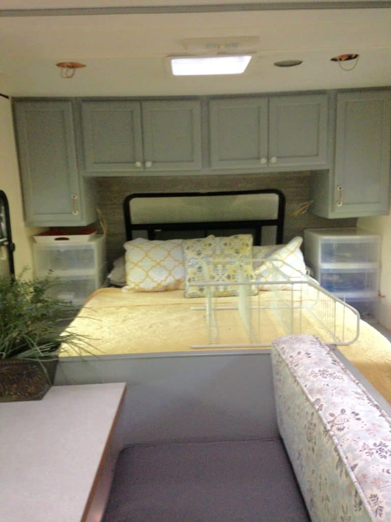 picture of our RV bedroom after painting the cabinets and walls. Camper remodel before and after