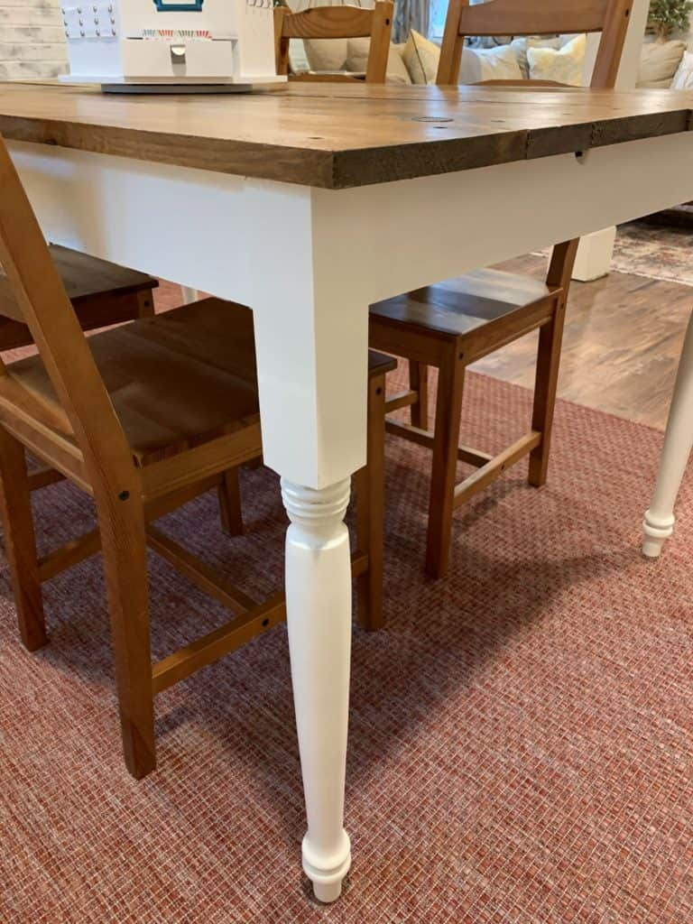 How to finish a pine farmhouse table.  close up of painted legs